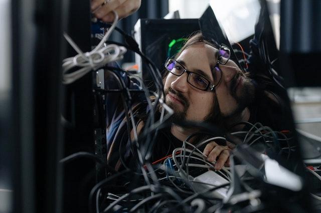 man fixing server cables pexels-cottonbro-6804585